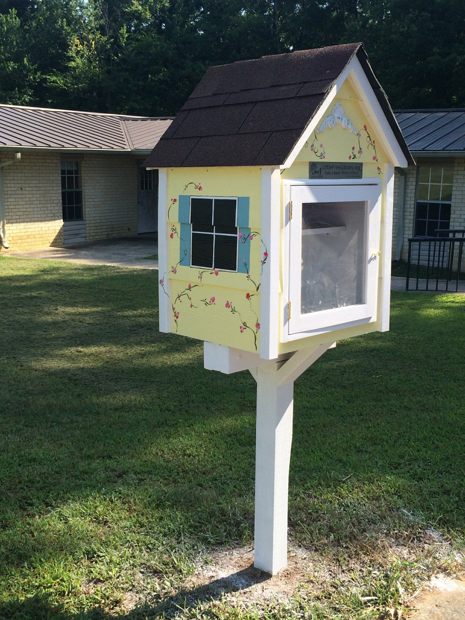 Yellow Little Free Library at Summerville Homes Community Center
