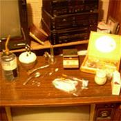Illicit drugs and paraphernalia atop a console television.