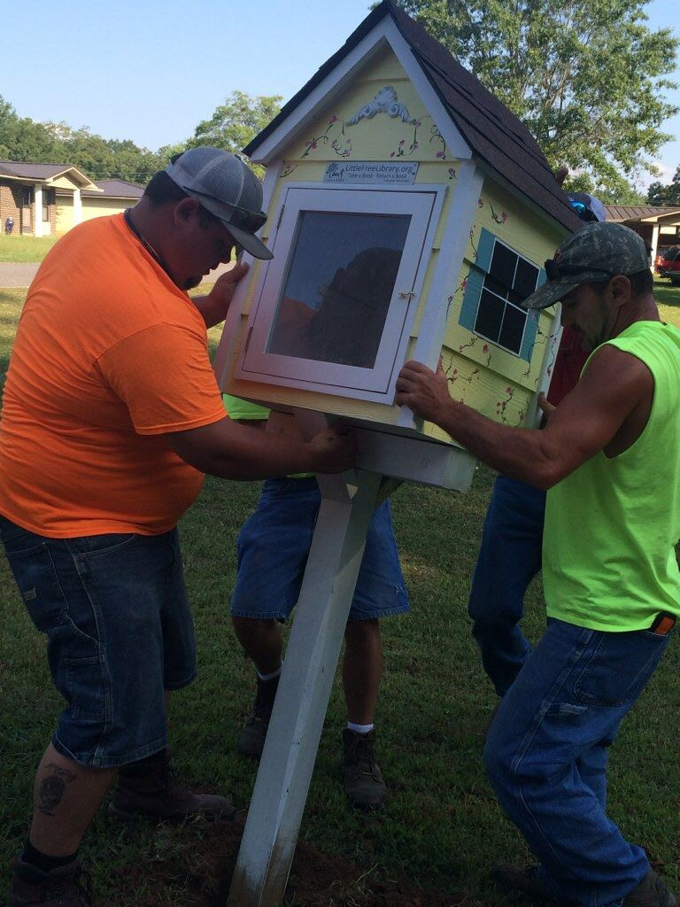 Street Department installing Little Library