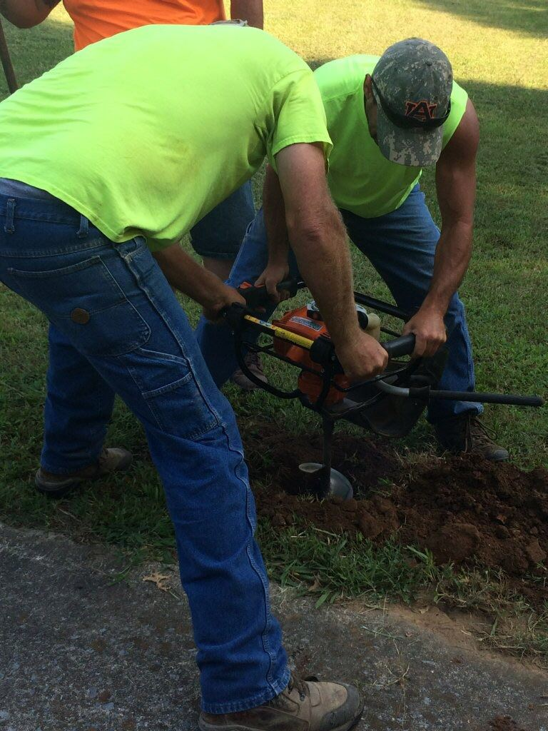 Street Department digging hole to install Little Library